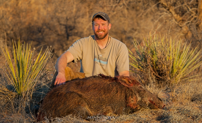 Bret Amundson with a wild Texas hog.