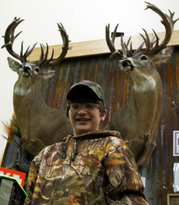 Dylan, his 28 point buck and the replica.  Can you guess which one is the replica?