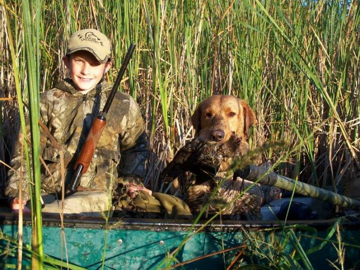 Avery and Bryce Hammerschmidt III with Bryce's first duck.