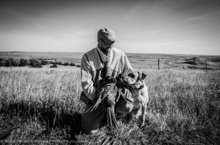 Bret Amundson, Mika and a limit of South Dakota roosters.