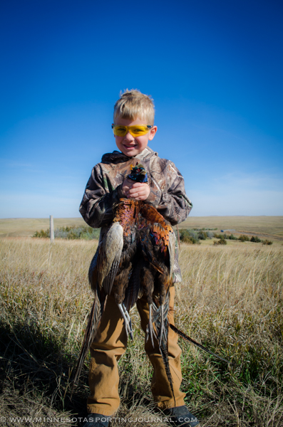 Christopher Roberts holds up some SD roosters