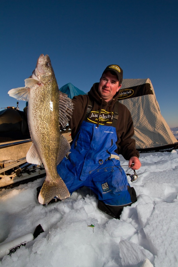 Jason Mitchell with a trophy walleye.  Matching your strategy to the time of day is especially important with walleye fishing.