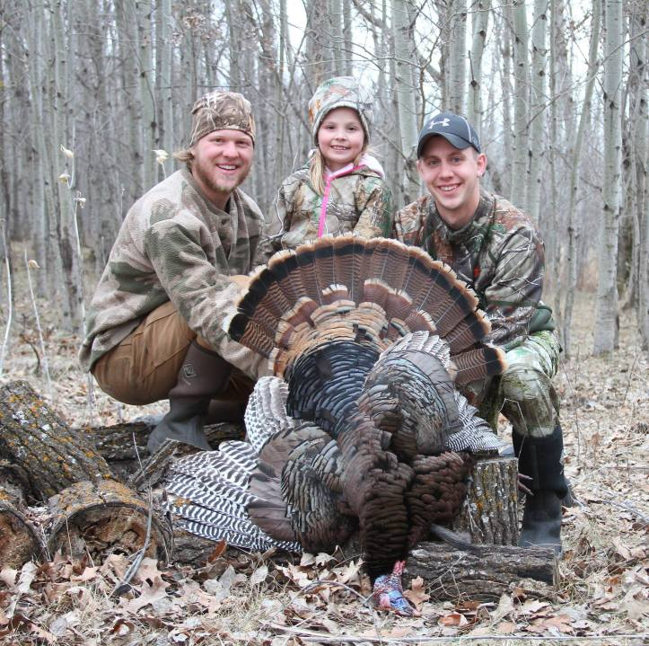 """Kali Knutsen with her first turkey!  7 years old, with the Cory Loeffler """"Guide service!"""""""