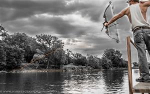 Dillon Brickweg lets an arrow fly at a carp.