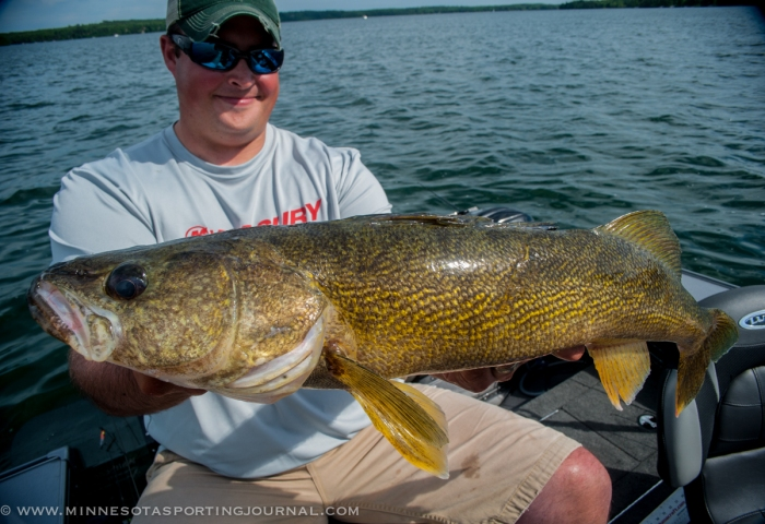 "Jason Freed with his 27"" walleye."