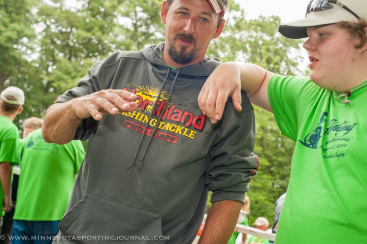 Jamie Dietman talks to one of the anglers at Fishing Has No Boundaries