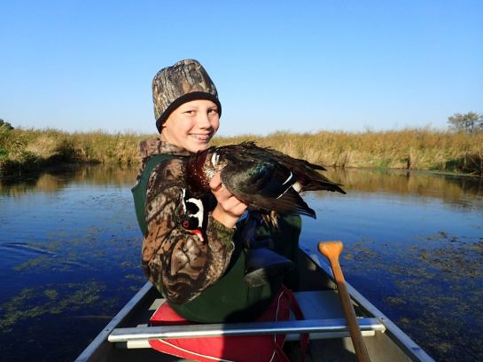 """Dave Jungst submitted this photo and added: """"Another warm day. Hardly seems like duck opener weather, but it was a beautiful day to float hunt the river and my mentee, Bennett did a great job with his 20 gage and bagged a limit of Wood ducks."""""""