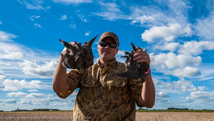 Richard Shamla holds up his doves