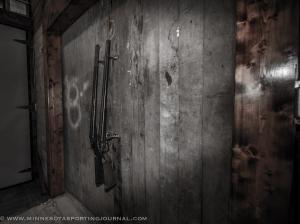 Double barreled shotguns open double doors in the brewery