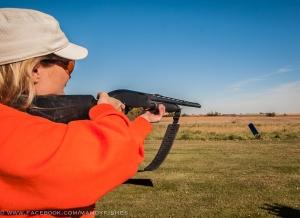 Mandy Uhrich breaks clays at the Worthington Gun Club