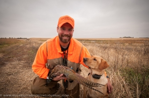 Bret Amundson and his lab Mika admire a western Minnesota long tail