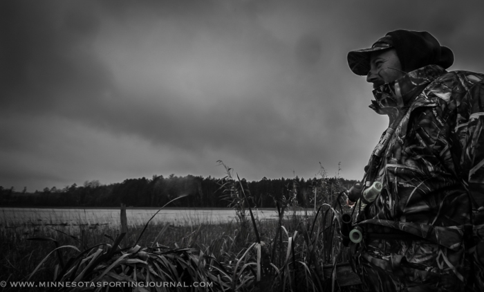 Jamie Dietman scans the horizon for ducks as the rain moves in.