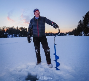 Bill Sherck using a hand auger during our primitive camping trip to the Boundary Waters area.