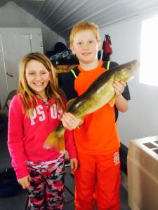 Grace and Eben with a walleye