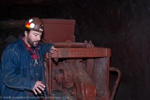 Tour guide Charlie Weidenhoft explains EIMCO loaders