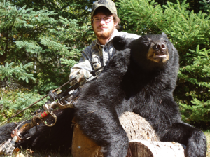 Brandon Greeley with a bear that was poached.   Photo courtesy of the MN DNR